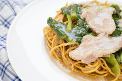 Crispy fried noodle with pork and kale soaked in gravy Stock Photography