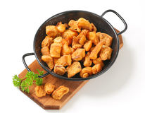 Crispy fried pork greaves Stock Photos