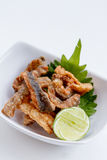 Crispy Fried Salmon Skin Served with Lime Stock Photography