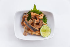 Crispy Fried Salmon Skin Served with Lime Stock Images