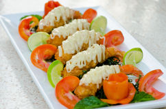 Crispy-fried shrimps with lime sauce Royalty Free Stock Photo