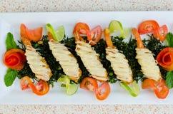 Crispy-fried shrimps with lime sauce Stock Photo