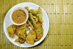 Crispy fried vegetable coating flour and egg eat couple with spicy shrimp pasted sauce on plate stock photography