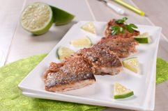 Crispy fried white fish fillets with lime Royalty Free Stock Images