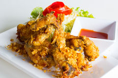 Crispy frog legs. With garlic and pepper Stock Photo