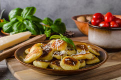 Crispy gnocchi with cheese and herbs. Roasted gnocchi with garlic and Parmesan, delicious crispy food Royalty Free Stock Image