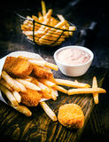 Crispy golden deep fried fish and chips Royalty Free Stock Images