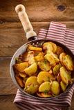 Crispy golden fried potato wedges with bacon Stock Photos