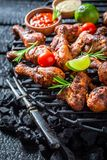 Crispy grilled chicken leg with sauces and lime Royalty Free Stock Images