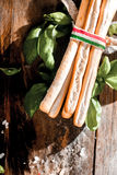 Crispy grissini bread sticks with fresh basil Royalty Free Stock Photo