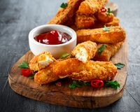 Crispy Halloumi cheese sticks Fries with Chili sauce for dipping. Crispy Halloumi cheese sticks Fries with Chili sauce for dipping Stock Photo