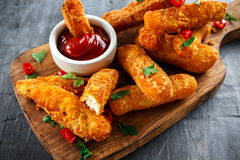 Crispy Halloumi cheese sticks Fries with Chili sauce for dipping. Crispy Halloumi cheese sticks Fries with Chili sauce for dipping Stock Photos