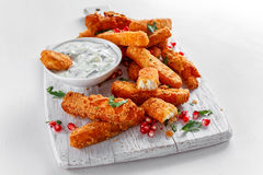 Crispy Halloumi cheese sticks Fries with yogurt for dipping and pomegranate seeds. Crispy Halloumi cheese sticks Fries with yogurt for dipping and pomegranate Royalty Free Stock Photography