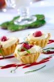 Crispy muffins with cream. Crispy muffins with vanilla cream and raspberries Stock Photo