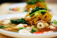 Crispy noodles in water topping Royalty Free Stock Image