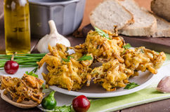 Crispy onion bhajis. Delicious street food, with herbs and garlic Stock Photography