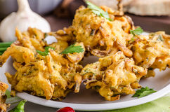 Crispy onion bhajis. Delicious street food, with herbs and garlic Royalty Free Stock Photography