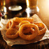 Crispy onion rings with parchment Royalty Free Stock Photo
