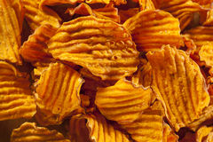 Crispy Orange Sweet Potato Chips Stock Photos