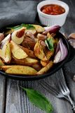 Crispy oven-baked potato slices in a pan Royalty Free Stock Image