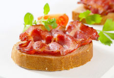 Crispy pan-fried slice of pork on bread Stock Photography