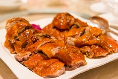 Crispy pecking duck. Authentic chopped delicious pecking duck stock images