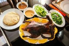 Crispy Peking duck with pancakes. Shallots, cucumber Stock Photos
