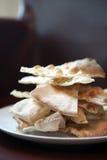 Crispy pizza bread on white plate Stock Photos