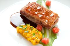 Crispy pork fillet with mango chutney. Royalty Free Stock Photography