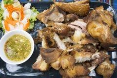 Crispy pork knuckle or German Pork Hocks and vegetable served with spicy seafood sauce Stock Photos