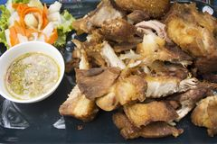 Crispy pork knuckle or German Pork Hocks and vegetable served with spicy seafood sauce Royalty Free Stock Images