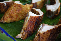Crispy pork placed on banana leaf Stock Photo