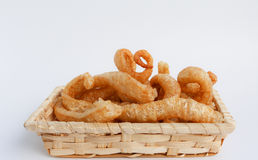 Crispy Pork Skin , Thai style food  in a wicker basket Royalty Free Stock Photo