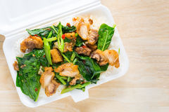 Crispy pork Stir-fried kale with steamed rice in Styrofoam food Stock Photography
