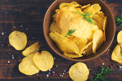 Crispy potato chips with a bowl, top view, tinted Royalty Free Stock Photos