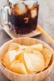 Crispy potato chips with iced cola Royalty Free Stock Photography