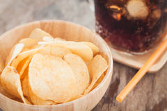 Crispy potato chips with iced cola Stock Photos