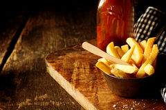Crispy potato chips or wedges with ketchup Stock Photo