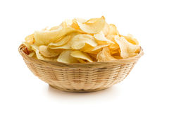 Crispy potato chips in a wicker bowl Royalty Free Stock Photo