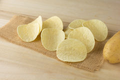 Crispy potato chips. On a wooden boards royalty free stock photography