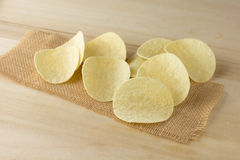 Crispy potato chips. On a wooden boards royalty free stock images