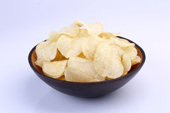 Crispy potato chips in wooden bowl  on white background Stock Images