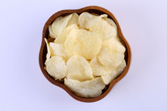 Crispy potato chips in wooden bowl  on white background Stock Photography