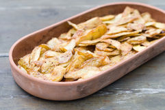 Crispy potato skins in crockery. Snack food stock photo