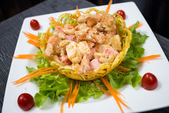 Crispy Prawns with Fruit Salad. In Mayonnaise and sesame Dressing Royalty Free Stock Photography
