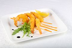 Crispy prawns. Served lemon slice stock photography