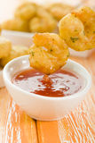 Crispy Prawns Skewers. Asian style fried battered prawns on skewers served with sweet chili dip Royalty Free Stock Photography