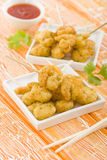 Crispy Prawns Skewers. Asian style fried battered prawns on skewers served with sweet chili dip Stock Image
