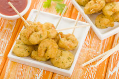 Crispy Prawns Skewers. Asian style fried battered prawns on skewers served with sweet chili dip Royalty Free Stock Photo