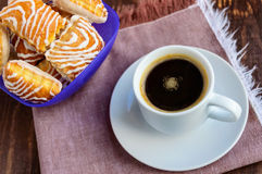 Crispy puff cookie with white chocolate and black coffee cup Stock Image